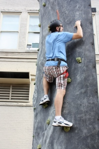 VA RLC member Steven Latimer climbs the rock wall.